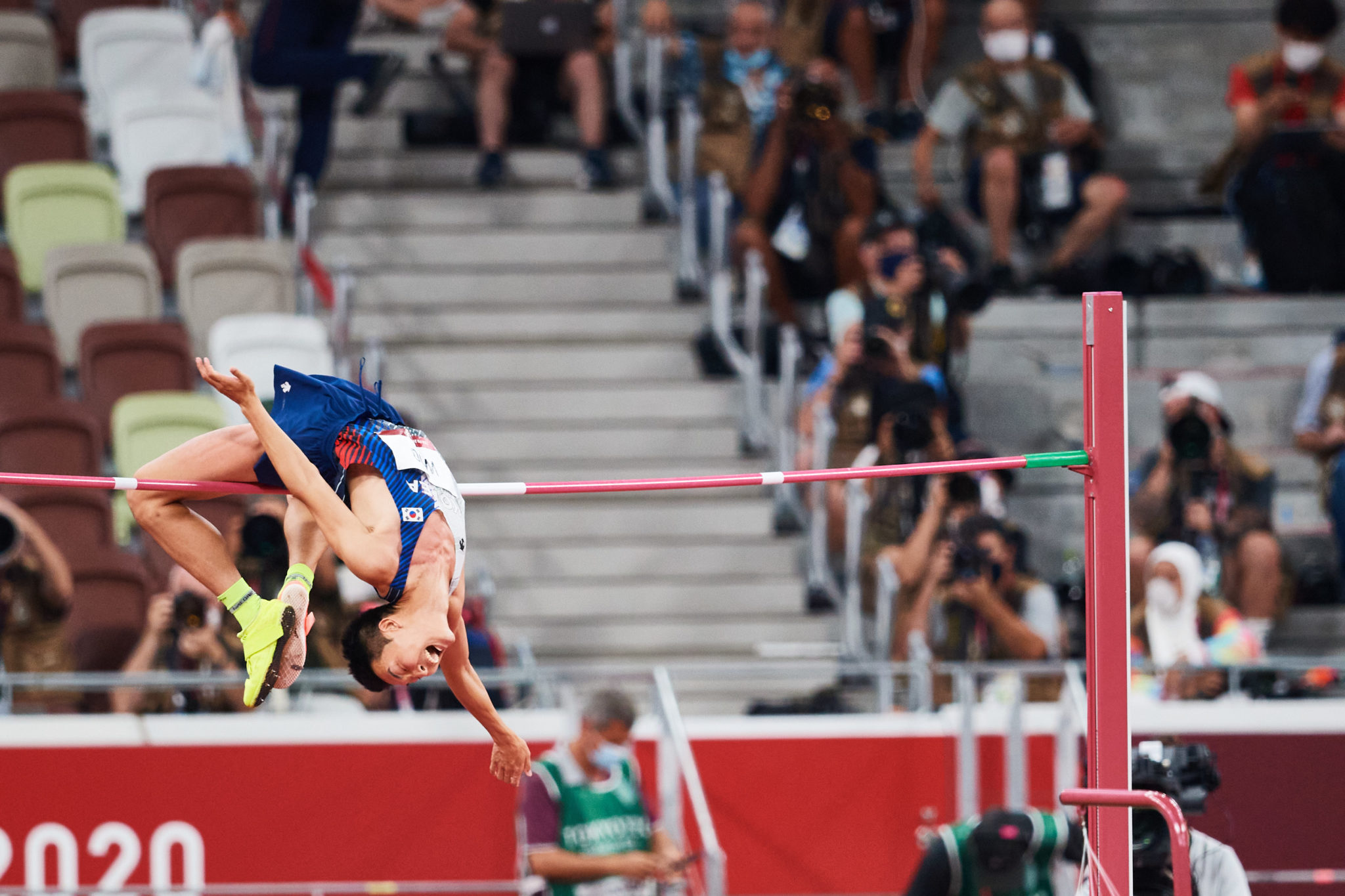 Photograph of Woo Sanghyeok of the Republic of Korea in the men's high jump final during the 2020 Tokyo Olympics at the Olympic Stadium in Tokyo, Japan.