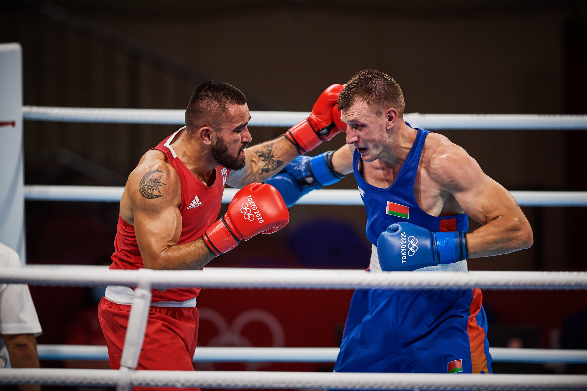 Photo: Uladzislau Smiahlikau (in blue) from Belarus beat Ato Leau Plodzicki-Faoagali (in red) from Samoa in the men's heavyweight boxing preliminaries Round of 16 during 2020 Tokyo Olympics at the Kokugikan Arena in Tokyo, Japan.
